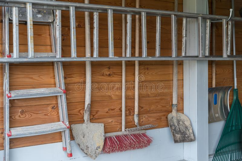 Garden tools arranged in garage. Trim of garden tool in a garage on the wall royalty free stock photos