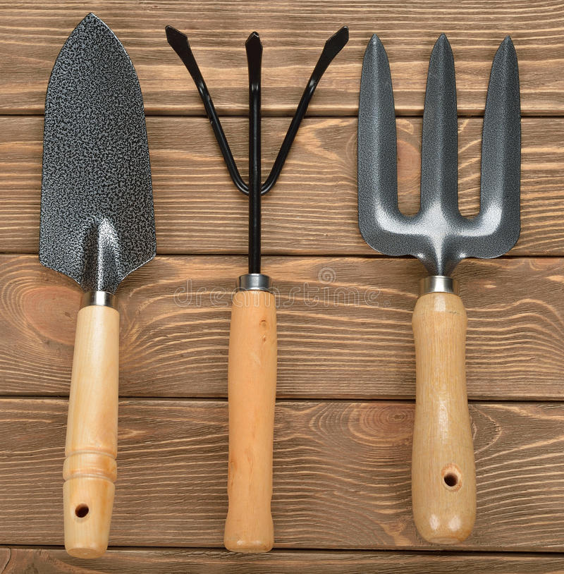 Garden tools. On brown background stock photography