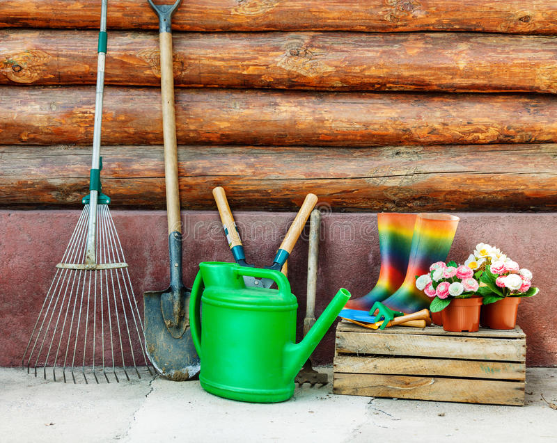 Garden tools. Photo against wooden wall royalty free stock photography