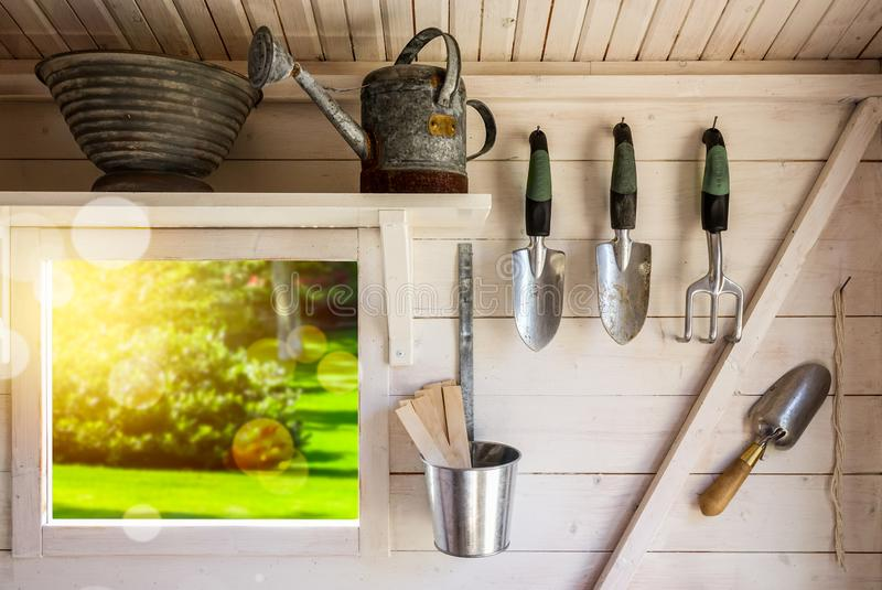 Garden tools in a small storage shed. stock images