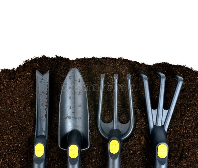Garden tools on soil. royalty free stock image