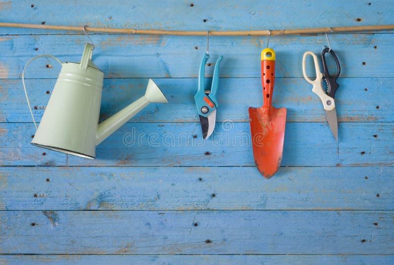 Garden tools. Watering can, scissor,shovel, free copy space stock photos