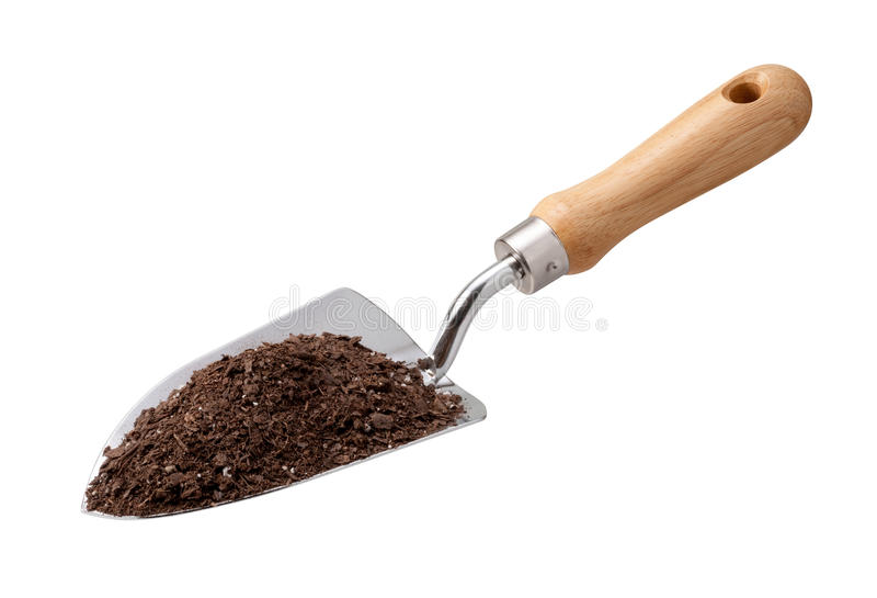 Garden Trowel with Potting Soil. Isolated on white with a clipping path. The image is in full focus, front to back. The isolation is on a transparent background royalty free stock images