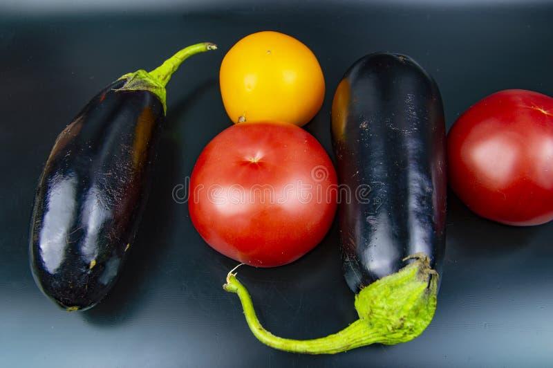 Garden vegetables on a black background. Food stock image