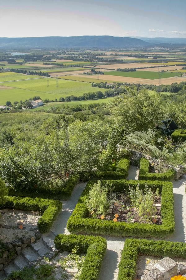 Garden and view of the country from La Garde Adhemar royalty free stock photography