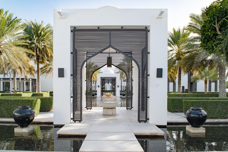 Garden with water basin and path with oriental gates in luxury hotel asian style royalty free stock photography