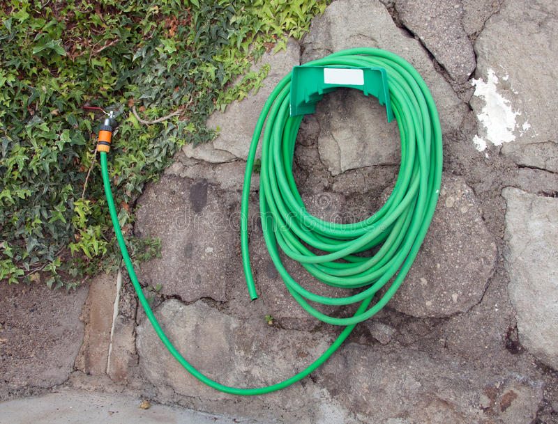 Garden water hose with tap royalty free stock images