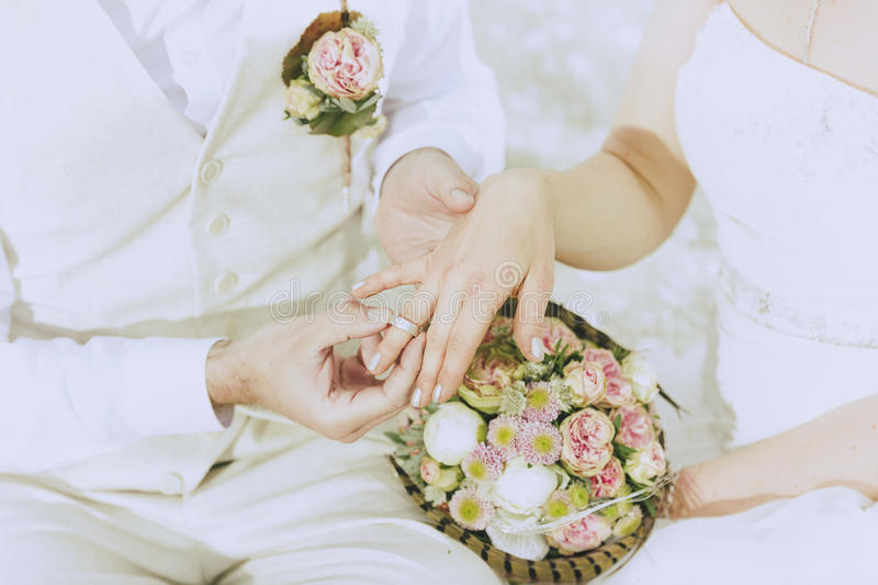 Garden Wedding exchange rings stock image