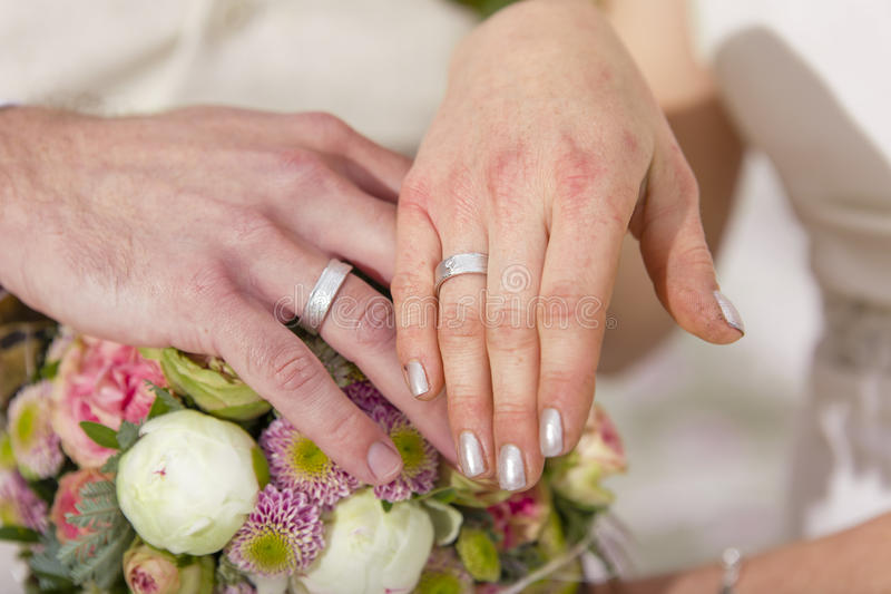Garden Wedding exchange rings royalty free stock photos
