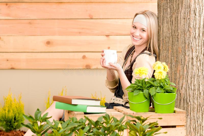 Garden woman terrace enjoy cup coffee spring. Garden woman terrace enjoy rest with cup coffee plant royalty free stock images