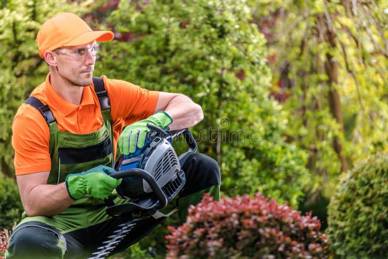 Garden Worker with Trimmer stock photos