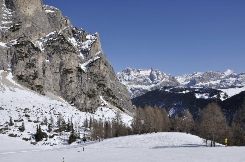 Gardenaccia and la villa ski area, dolomites. View of famous mountain in dolomite with steep cliffs and snowy slopes, shot in bright winter light with ski area stock photo