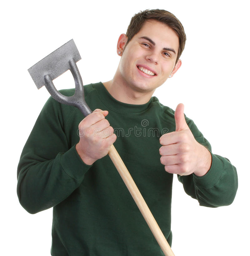Gardener. With hoe wearing a green jumper stock image