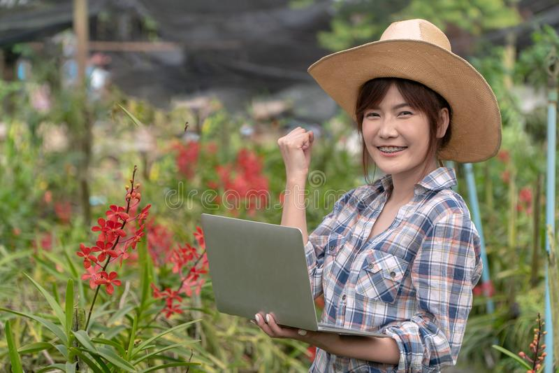 The gardener arranged the orchid garden by holding the notebook and holding the right hand. To express joy and increase sales royalty free stock photos
