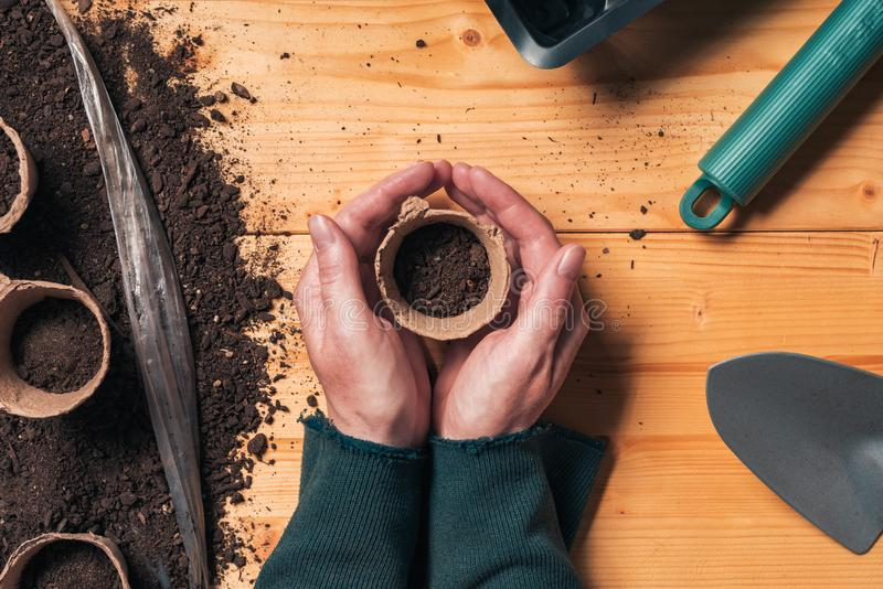 Gardener with biodegradable soil pot container stock photos