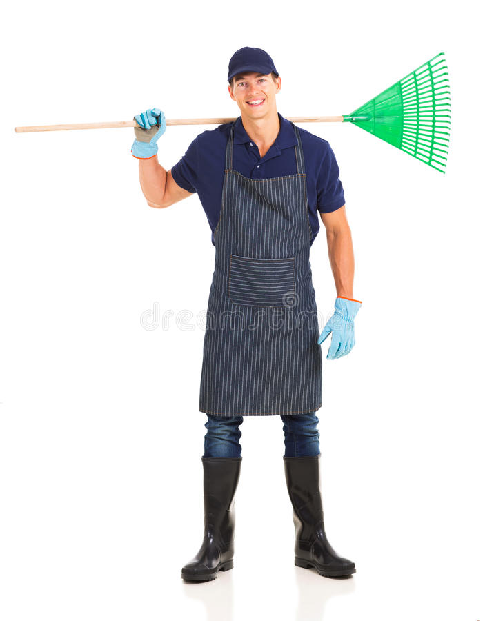 Gardener carrying rake stock images