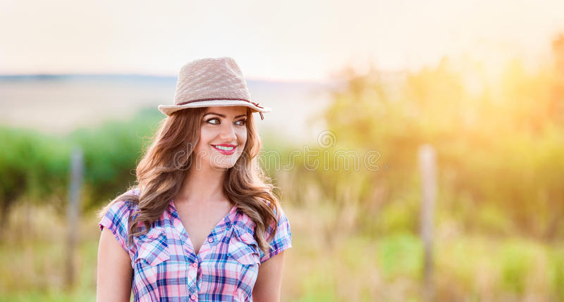 Gardener in checked shirt and hat, green sunny nature royalty free stock photo