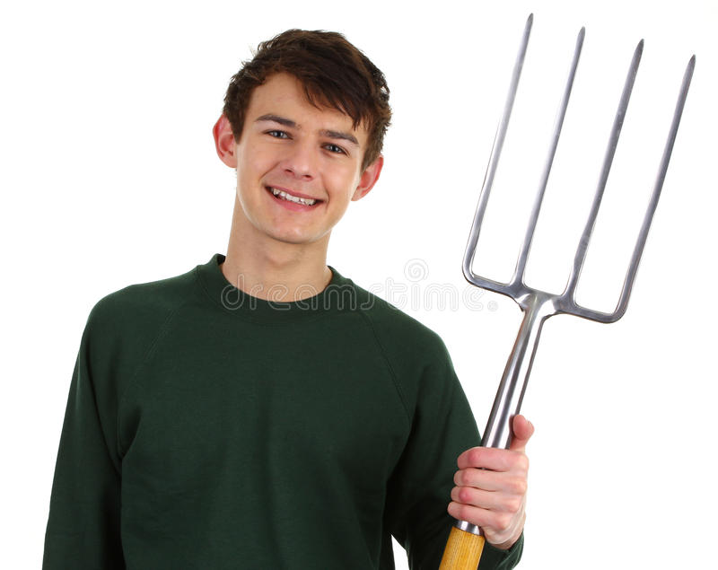 Gardener with a fork. A happy gardener with a fork stock photo