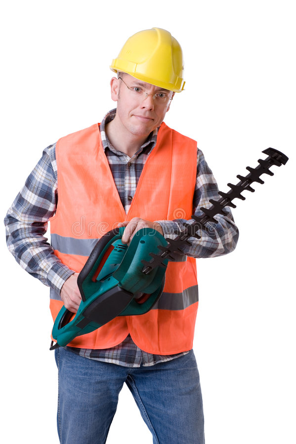 Gardener with hedge trimmer royalty free stock photography