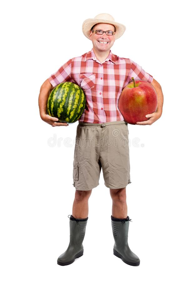 Gardener holding water melon and red apple stock photo