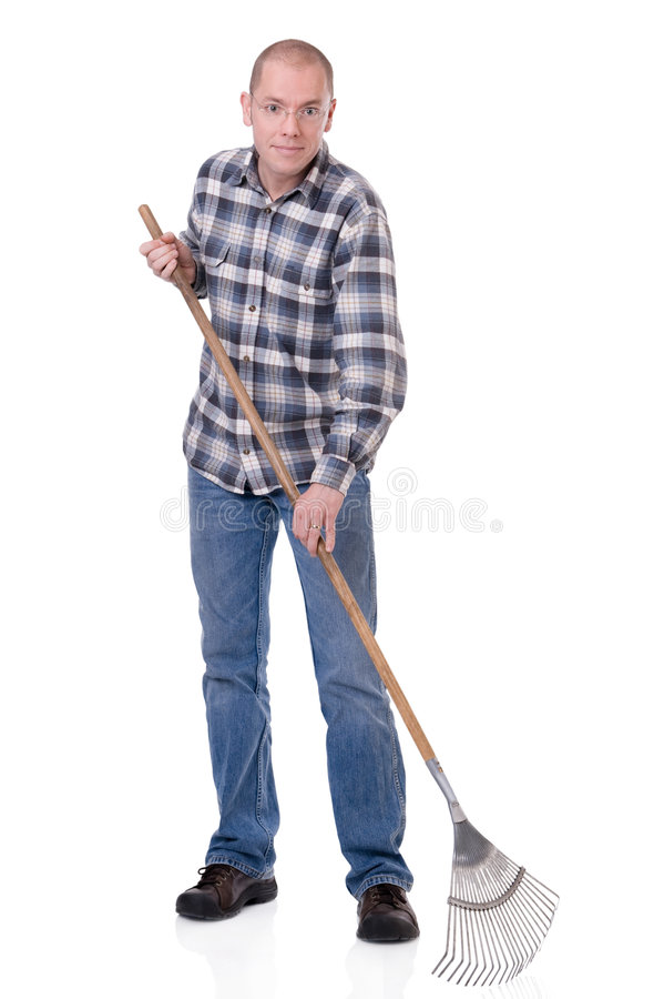 Gardener with a rake. Full isolated studio picture from a young gardener with a rake royalty free stock photo