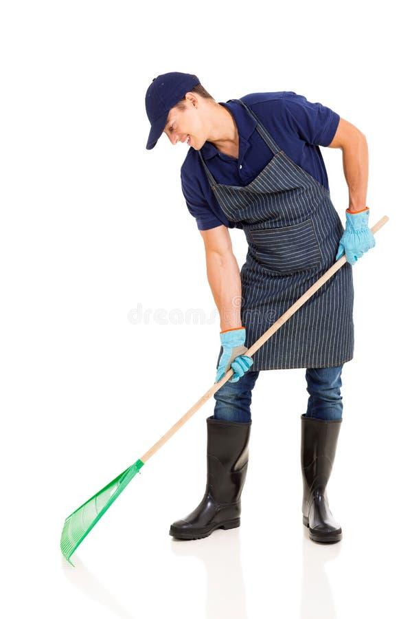 Gardener raking royalty free stock photography