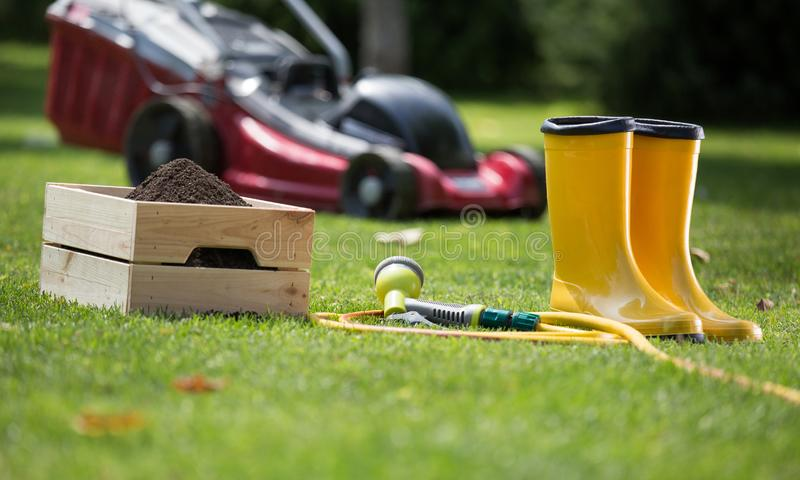 Gardening equipment on grass royalty free stock photography