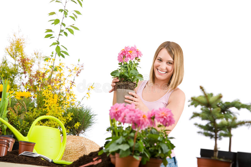 Gardening - Happy woman holding flower pot stock photos
