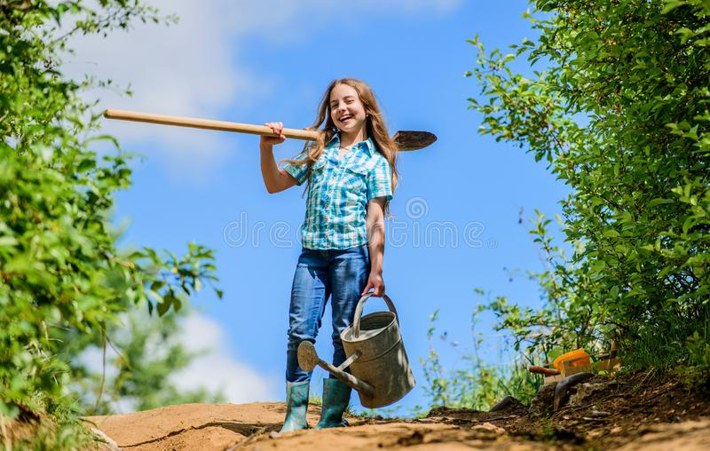 Gardening. kid worker sunny outdoor. family bonding. spring country side village. future success. little girl on rancho royalty free stock images