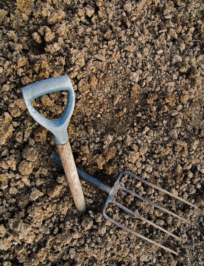 Gardening metaphor - rocky ground, broken fork, abandoned hope. Hard work gardening image royalty free stock photo