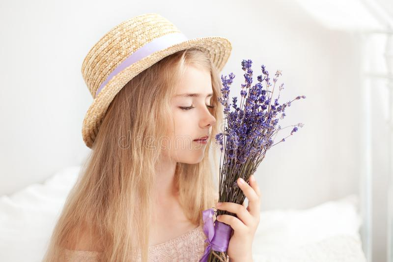 Gardening and people concept happy young woman smelling lavender flowers. Cute little Girl holds a bouquet of lavender. Lifestyle. Concept. Aromatherapy royalty free stock photos