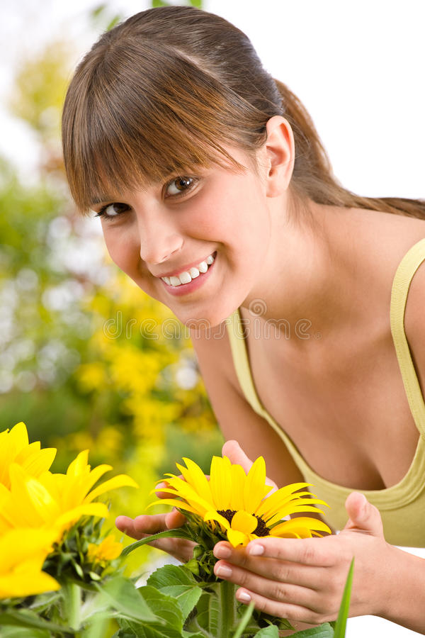 Download Gardening - Portrait Of Woman With Sunflower Royalty Free Stock Photos - Image: 14459918