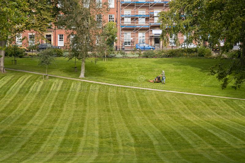 Gardening in Preston. Preston, United Kingdom - September 17 2019: A gardener mos the grass in Winckley Square stock photo