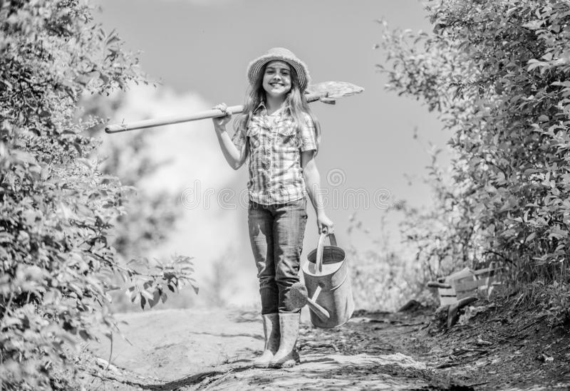 Gardening tips. Spring gardening. Girl child hold shovel watering can. Spring gardening checklist. Little helper. Watering tools that will solve dry yard royalty free stock photos