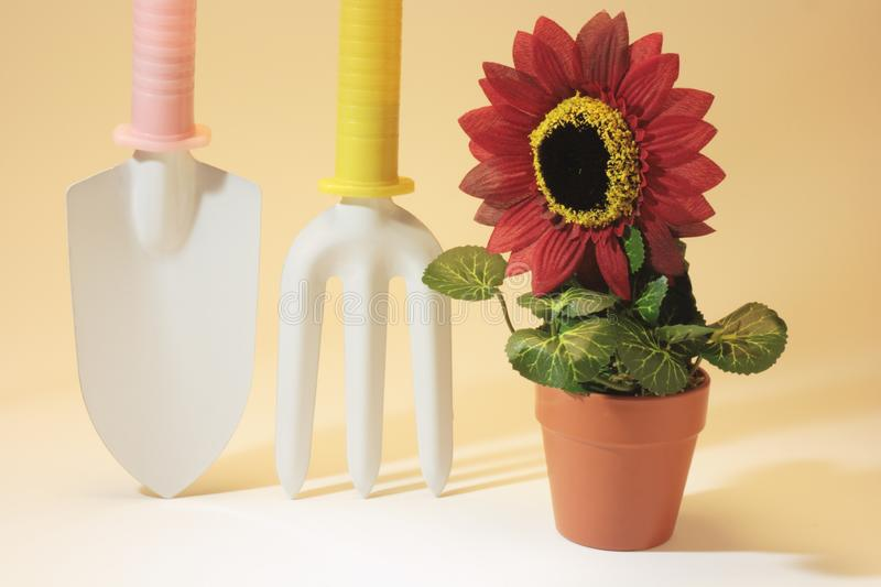 Gardening tools and Artificial Potplant royalty free stock photos