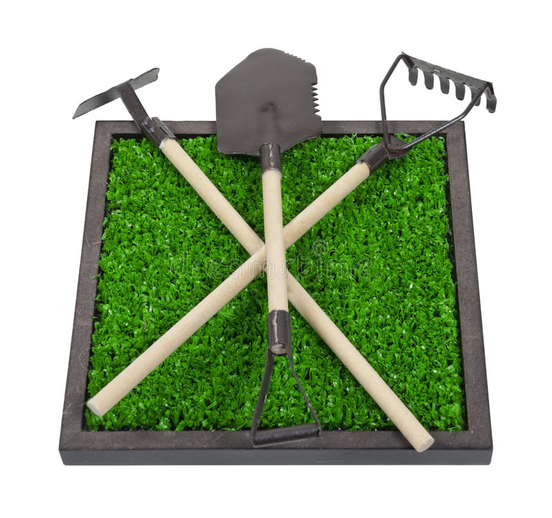 Download Gardening Tools On A Bed Of Raised Grass Stock Image - Image: 22368877