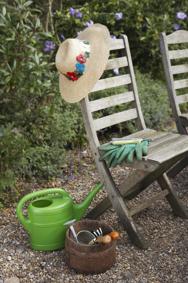 Gardening Tools And Chairs royalty free stock photos