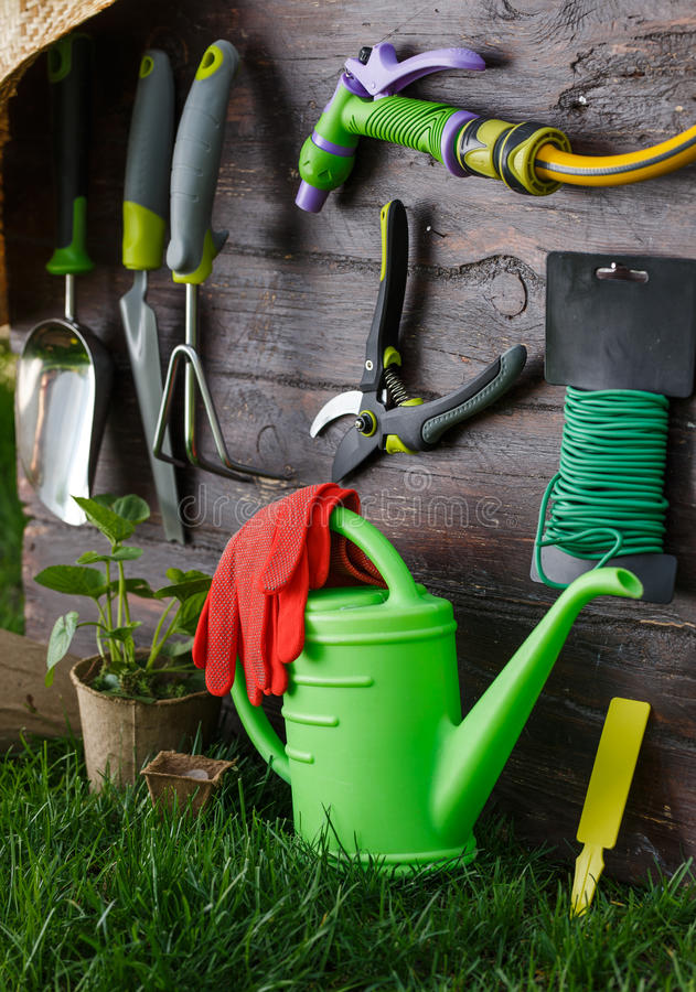 Gardening tools and equipment closeup in the backyard. stock photography