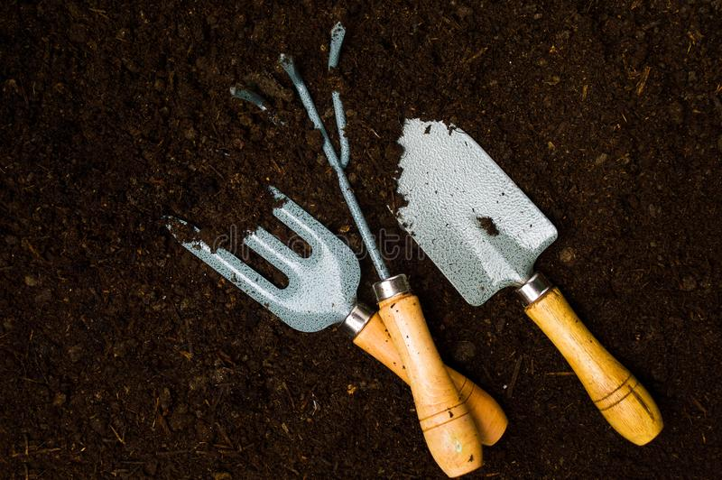 Gardening tools in the soil top view royalty free stock image