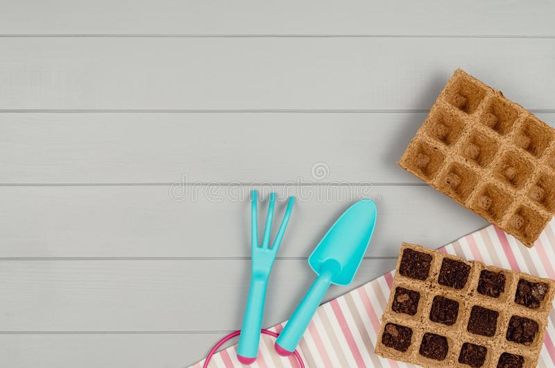 Gardening tools on gray wooden table background top view stock photography