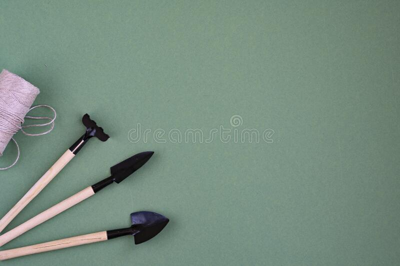 Gardening tools and top view, garden maintenance.  Mother earth day. Composition of garden tools stock photography