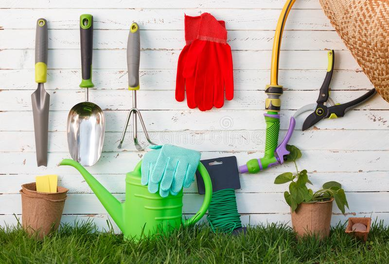 Gardening tools and utensils on green meadow, garden manteinance and hobby concept stock images