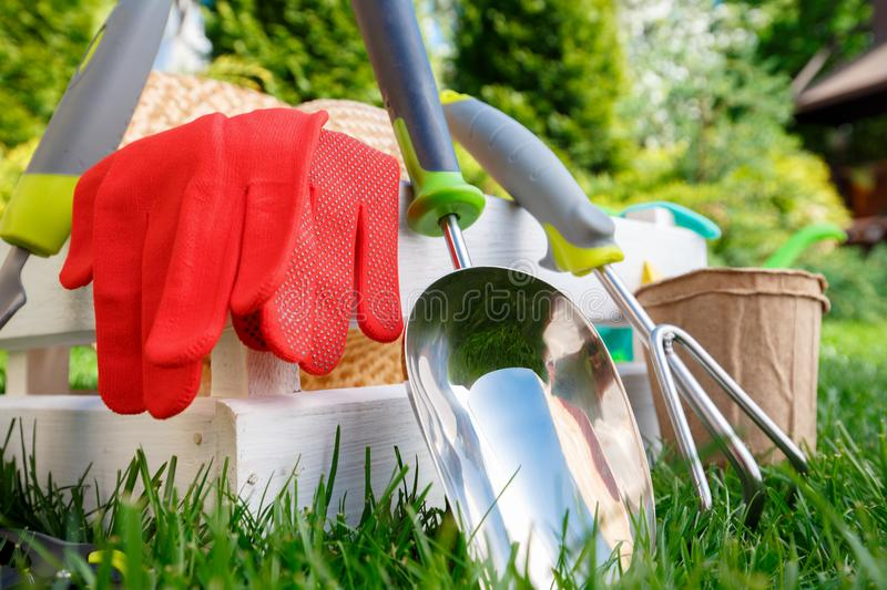 Gardening tools and utensils on green meadow, garden manteinance and hobby concept royalty free stock photography