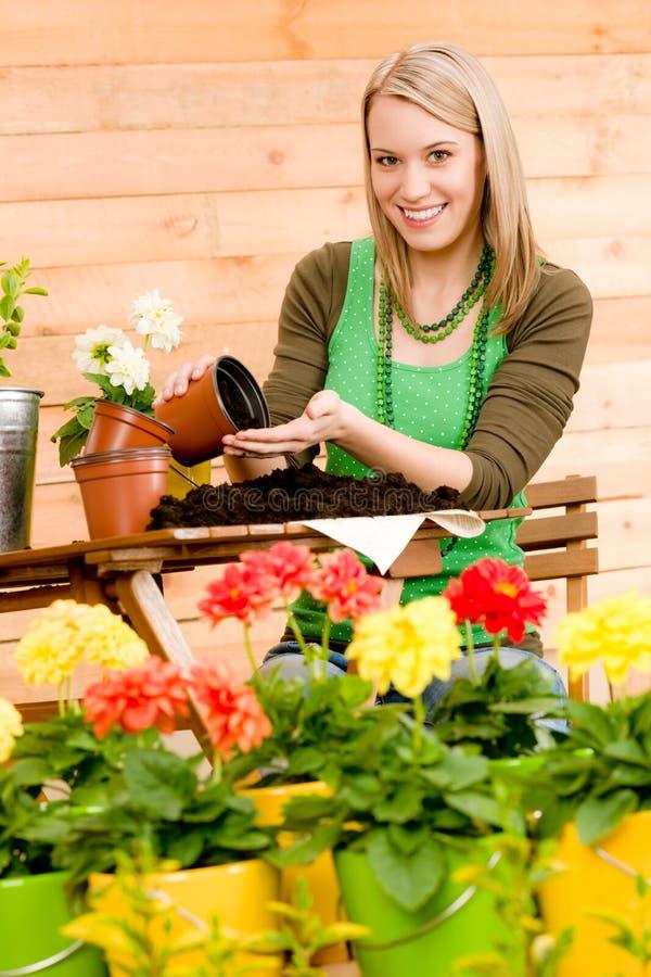 Gardening woman plant spring flower terrace stock photos