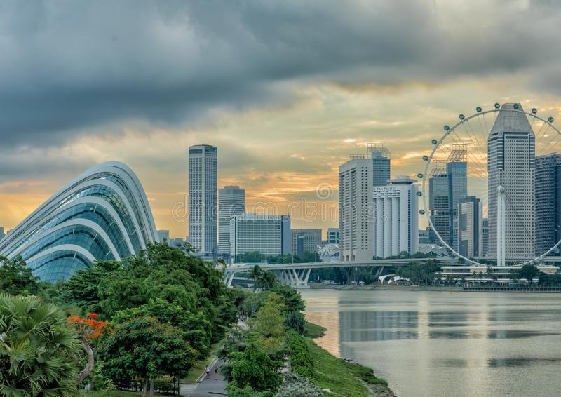 Gardens By The Bay & Singapore Flyer. Gardens By The Bay and Singapore Flyer at sunset stock image