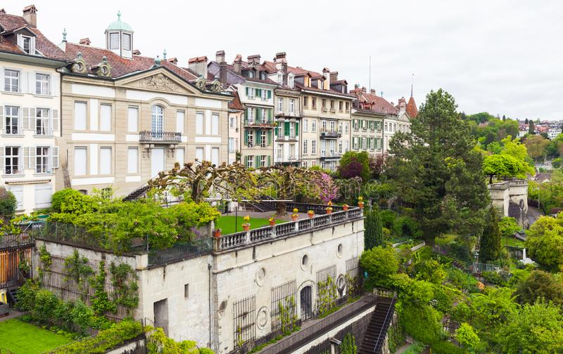 Gardens of Bern, Switzerland. Bern, Switzerland. Landscape with old living houses and gardens at cloudy day stock images