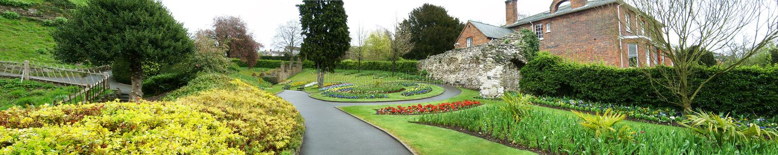 Gardens and flowers in Guildford. A stunning garden in guildford guild area. It has many flowers, including tulips, great lawn, pines and trees stock image