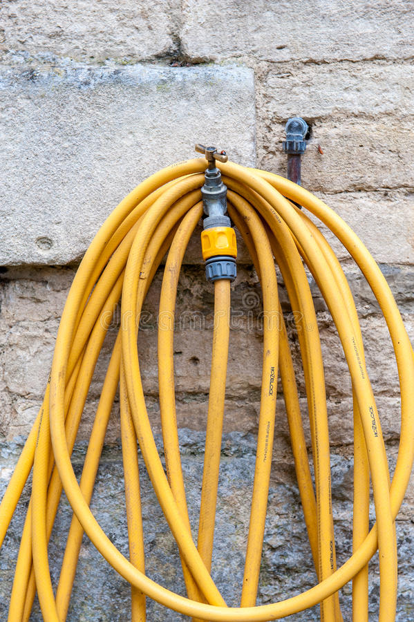 Gardens hose and tap royalty free stock image