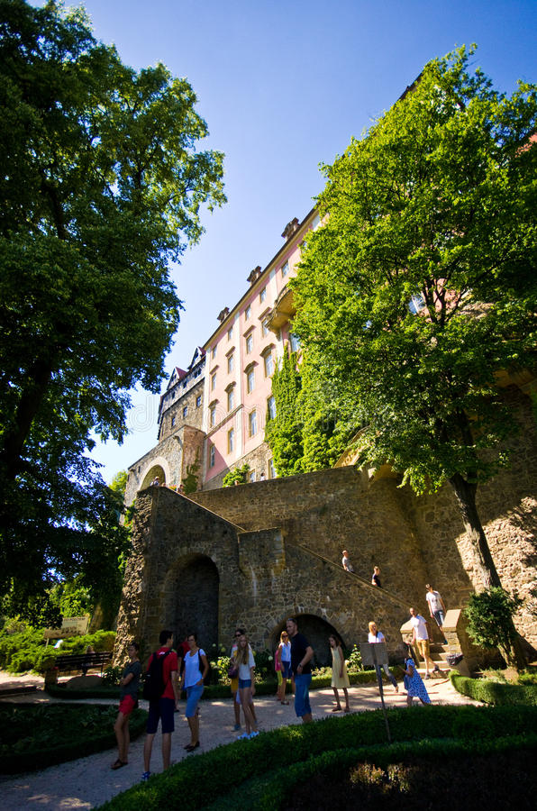 Gardens of Ksiaz Castle Poland. Visitors to Ksiaz Castle, Poland, admiring green gardens surrounding the building royalty free stock images