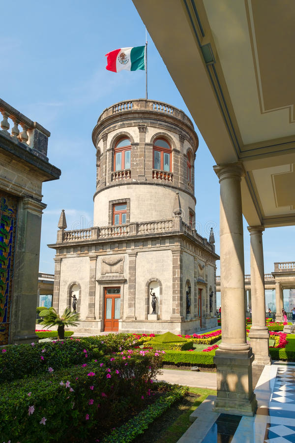 Gardens and tower with the mexican flag at Chapultepec Castle i. Beautiful gardens and tower with the mexican flag at the alcazar at Chapultepec Castle in Mexico stock photography
